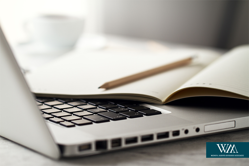 Closeup of Workspace with Modern Creative Laptop, Cup of Coffee