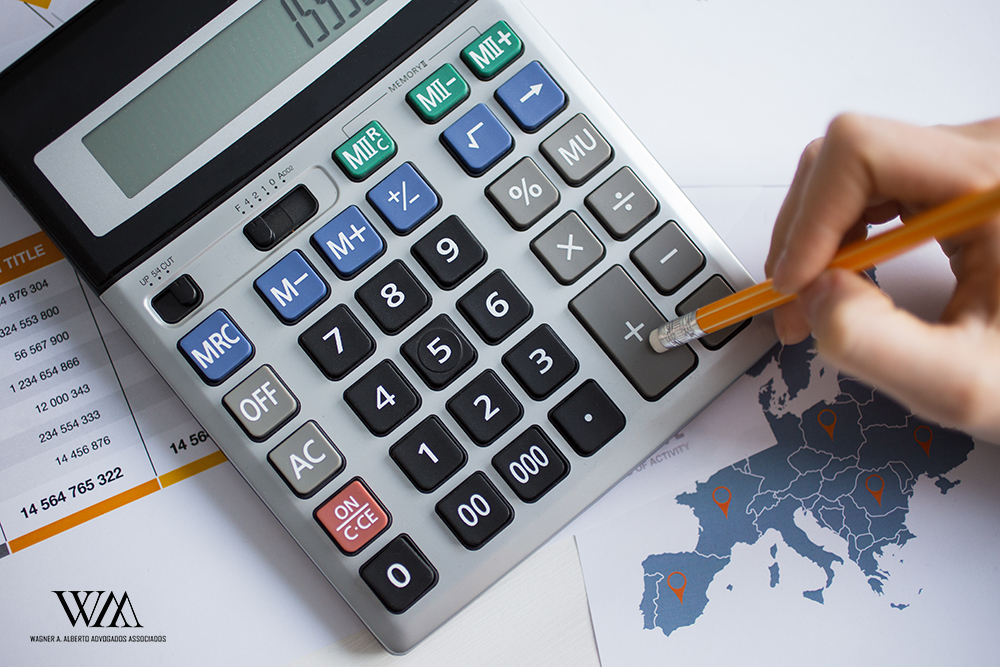 Cropped View of Man Hand Working With Calculator